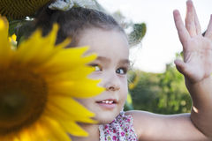 Child in sunflowers. Happy Child on the field with sunflowers royalty free stock photography