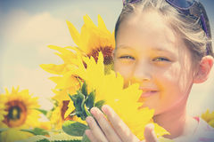 Child and sunflowers. In retro style Royalty Free Stock Photo