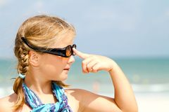 Child with sunglasses at the beach Stock Image