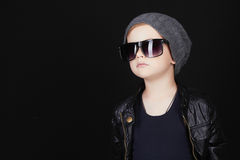 Child in sunglasses.fashionable handsome little boy in hat Stock Images