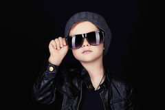 Child in sunglasses.fashionable handsome little boy in hat Stock Photos