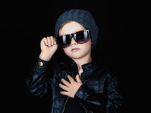 Child in sunglasses.fashionable handsome little boy in hat Royalty Free Stock Photo