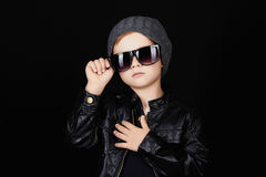Child in sunglasses.fashionable handsome little boy in hat Royalty Free Stock Images