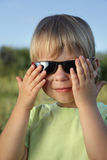 Child in sunglasses summer outdoors Stock Photos