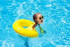 Child in swimming pool. Kids swim. Water play. Royalty Free Stock Image