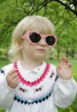 Child in sunglasses on a walk Royalty Free Stock Photo