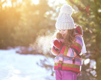 Child in sunny cold winter weather Stock Photos