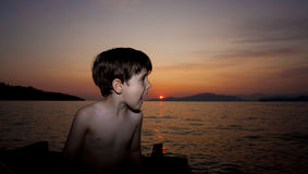 Child and sunset. Child close up portrait with flash over sunset Royalty Free Stock Image