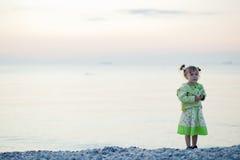 Child on sunset beach Royalty Free Stock Image