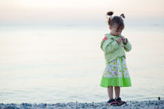 Child on sunset beach Stock Photo