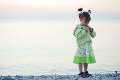 Child on sunset beach Stock Photo