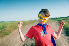 Child super hero. Child acting like a super hero Royalty Free Stock Photos