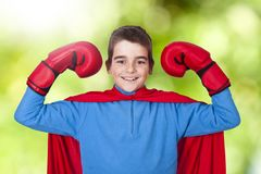 Child superhero. Costume and expression of strength and power royalty free stock photos