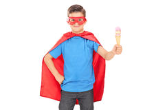Child in superhero outfit holding an ice cream Royalty Free Stock Photo