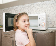 Child without supervision playing with microwave royalty free stock photos