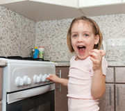 Child without supervision  playing with  stove Stock Photography