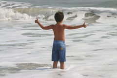 Child in the surf Royalty Free Stock Image