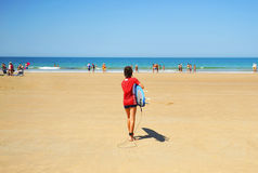 Child with surfboard on the beach, Costa de Cádiz, Andalusia, Spain Royalty Free Stock Photo