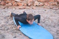 Child on surfboard stock photo