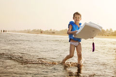 Child surfing Royalty Free Stock Images