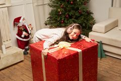 Child is surprised by big red gift for  new year Stock Image