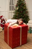 Child is surprised by big red gift for  new year Stock Photo