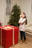 Child is surprised by big red gift for  new year Royalty Free Stock Images