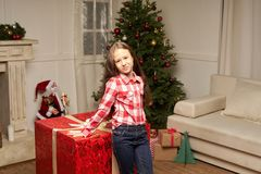 Child is surprised by big red gift for  new year Stock Images