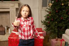 Child is surprised by big red gift for  new year Stock Photography