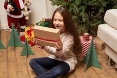 The child is surprised by the gift for the new year Stock Photos