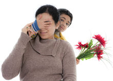 Child Surprises Mother with a Bouquet of Flowers Stock Image