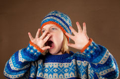 Child sweater angy hat boy Stock Photo