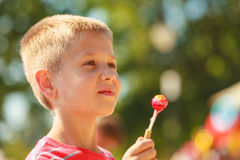 Child with sweet food outdoor. Royalty Free Stock Photos