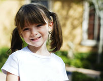 Child with sweet happy smile. Adorable young child with sweet happy smile on her face stock photos