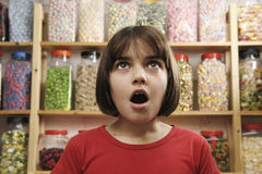 Child in sweet shop royalty free stock photography
