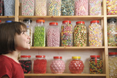 Child in sweet shop Stock Photography