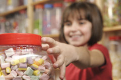 Child in sweet shop stock photos