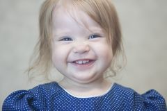 Child with a sweet smile. Beautiful smiling little girl. little blonde stock photography