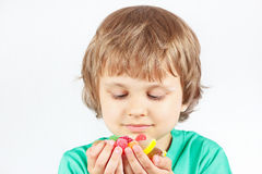 Child with sweets and jelly candies stock image