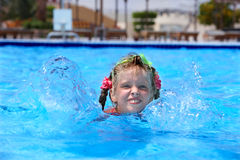 Child swim in swimming pool. Royalty Free Stock Photography