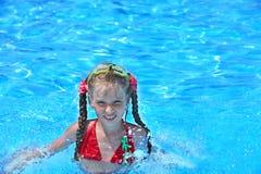 Child swim in swimming pool. Stock Photos