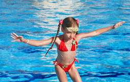 Child swim in swimming pool. Royalty Free Stock Photos