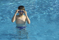 Child in swiming pool Stock Photo