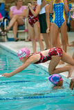 Child Swimmer Dives Into Pool In Relay Race Royalty Free Stock Images