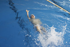 Child swimmer in swimming pool Stock Photo
