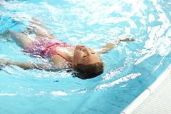 Child swimming backstroke. In the pool Royalty Free Stock Photography