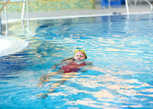 Child swimming backstroke. In the pool Royalty Free Stock Image