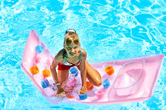 Child swimming on  beach mattress. Stock Images