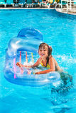 Child swimming on  beach mattress Stock Photography