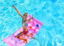 Child swimming on  beach mattress Royalty Free Stock Images